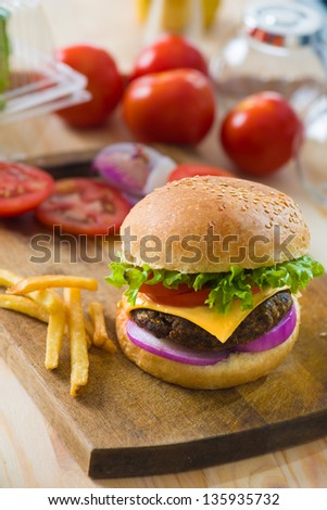 hamburger fast food with plenty of raw materials on the background
