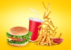 Hamburger, fried potatoes, ketchup and paper cup. Comercial high resolution fast food.