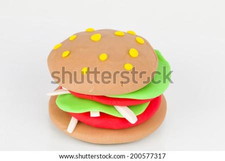 Hamburger from children bright plasticine - Stock Image macro.