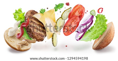 Hamburger ingredients hanging in the air. Colorful conceptual picture of burger cooking. Clipping path.