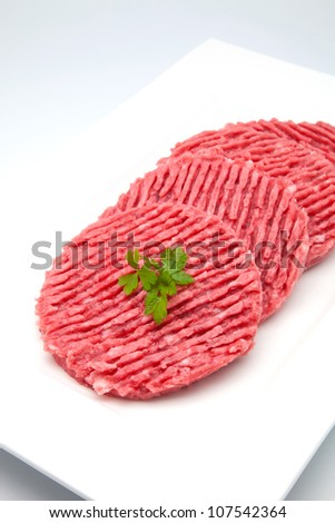 hamburger of raw meat ready to cook