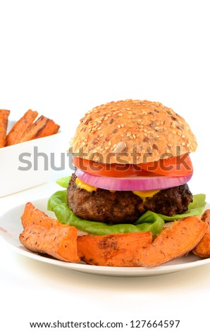 Hamburger on healthy whole grain bun with yam fries