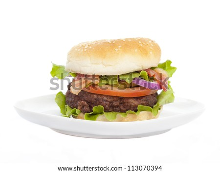 Hamburger on plate on white background