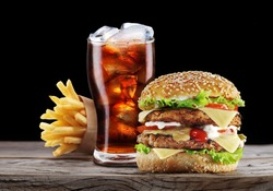 Hamburger, potato fries, cola drink. Takeaway food. Fast food.