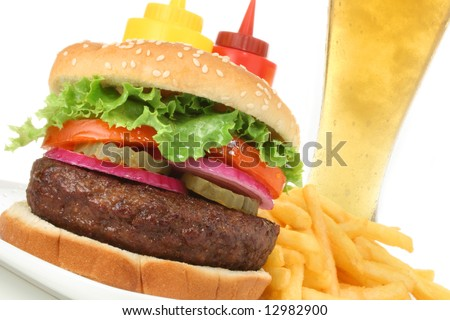 Hamburger served with french fries and cold beer angled. Fast food & barbecue collection.