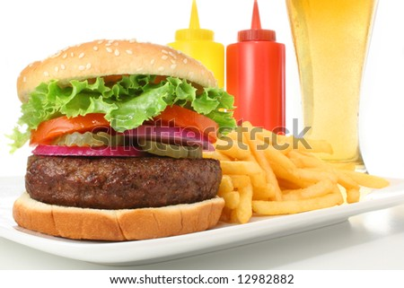 Hamburger served with french fries and cold beer. Fast food & barbecue collection.