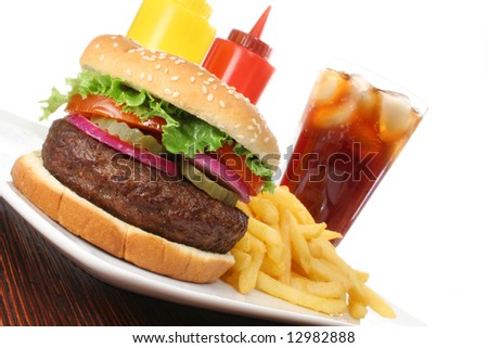 Hamburger served with french fries and soda angled. Fast food & barbecue collection.