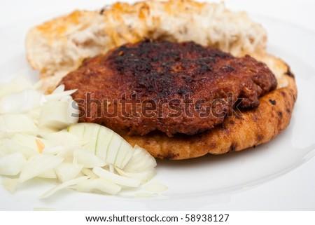 hamburger steak in flatbread (lepinja) with onion