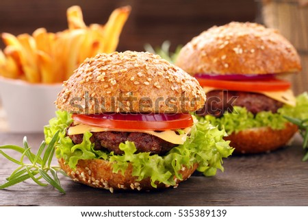 Hamburger with beef meat and chips with empty space for text