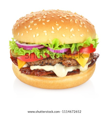 Hamburger with cheese, bacon, pickles, tomato, onions and lettuce isolated on white background. Clipping path included