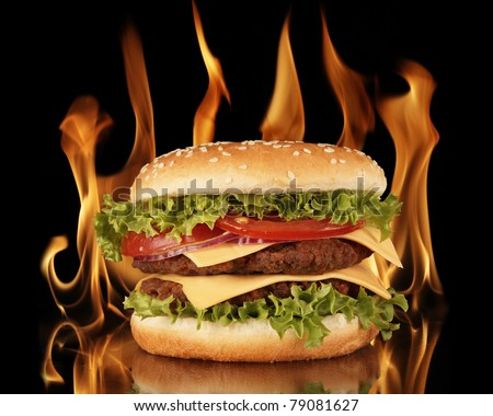 Hamburger with fire on black background