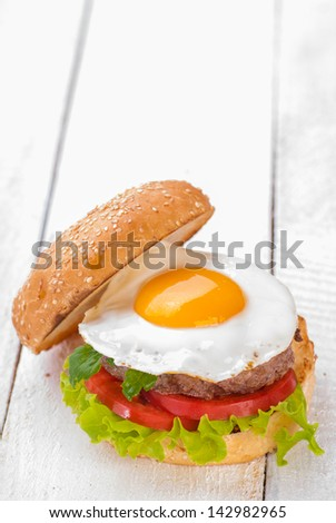Hamburger with fried eggs