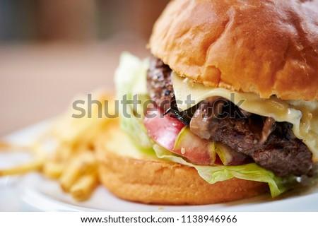 Hamburger with fried potato