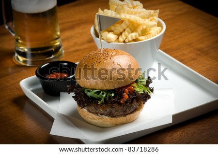 Hamburger with fries and beer.
