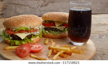 Hamburger with glass of cola drink