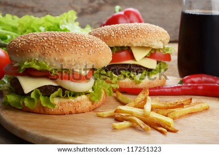 Hamburgers fried potatoes and drink - stock photo