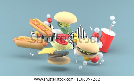 Hamburgers, hot dogs and soft drinks among colorful balls on a gray background.-3d rendering.