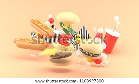 Hamburgers, hot dogs and soft drinks among colorful balls on an orange background.-3d rendering.