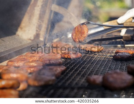 Hamburgers on barbecue grill #420335266