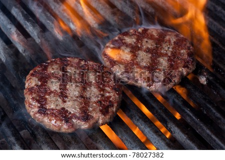 Hamburgers on Grill with Dancing Flames Cooked to Perfection