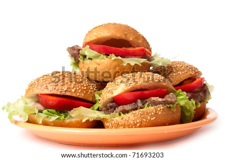hamburgers with vegetables on a orange plate