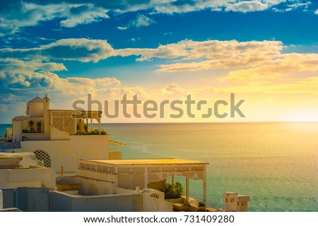 Hammamet, Tunisia. Image of architecture of old medina with dramatic sky at sunset time. #731409280