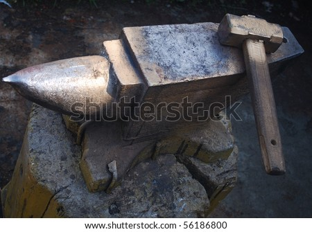 stock-photo-hammer-and-anvil-used-by-a-blacksmith-56186800.jpg
