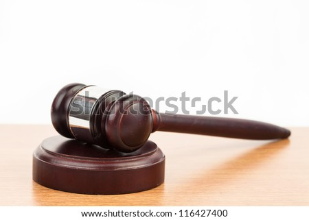Hammer and gavel on wooden desk