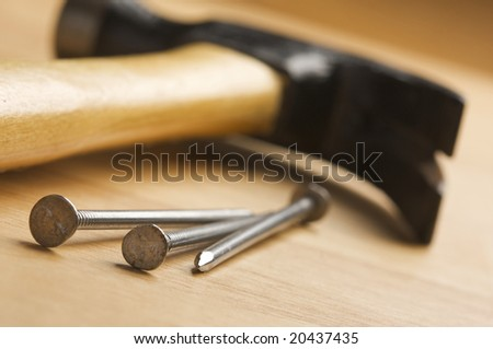 Hammer and Nails Abstract on Wood Background.