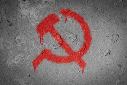 Hammer and sickle,Communism symbol spray painted on the wall
