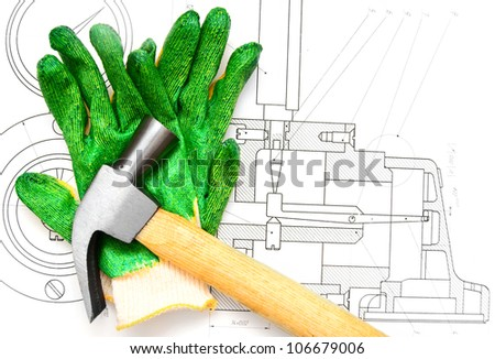 Hammer, gloves on the drawing.