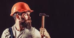 Hammer hammering. Builder in helmet, hammer, handyman builders in hardhat.