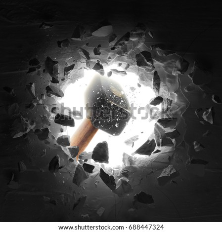 hammer hitting the wall causing hole and debris