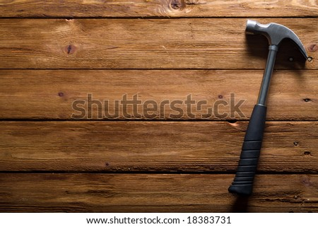 hammer on a wood board