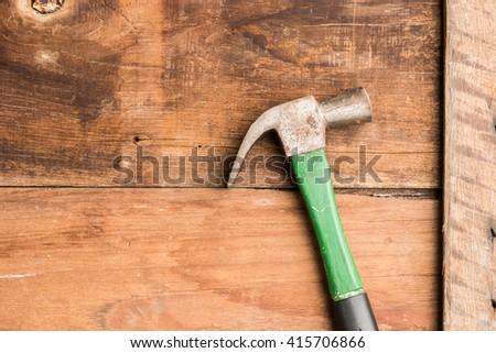 hammer on wood background #415706866