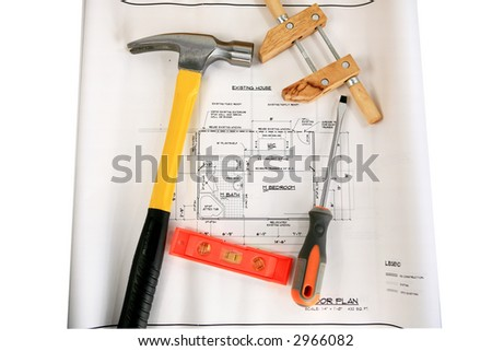 Hammer,screw driver,level and clamp tools on house addition plans