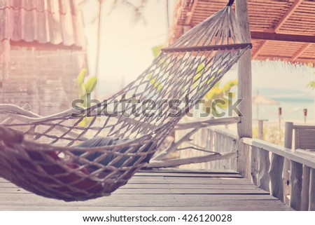Hammock in the cafe on the shore of tropical sea