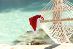 Hammock on a tropical beach resort in christmas holidays with the sea water in the background