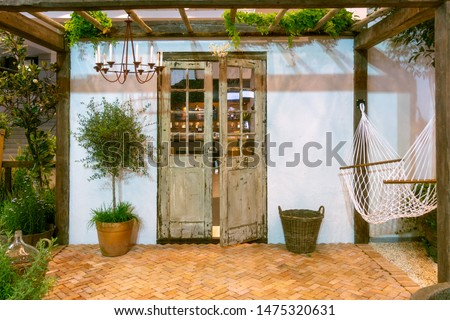 hammock on terrace with brick floor and pebble ground  under lathing shade in the garden mediterranean style. #1475320631