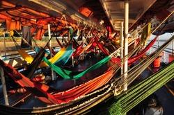 hammocks on an amazon river boat trip