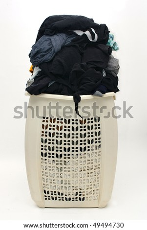 hamper bulging with tons of dirty clothes inside