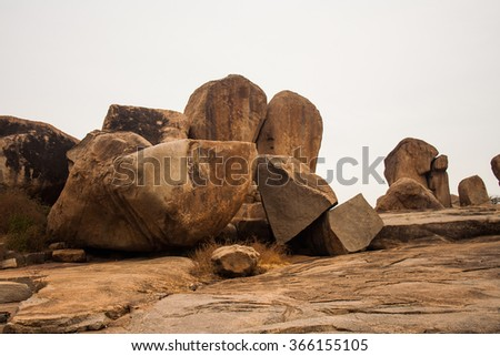 Hampi, India. Boulder rocks on hill overlooking Hampi with Isolated sky