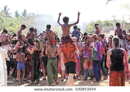 HAMPI, INDIA - MARCH 9: Unidentified people celebrate Holi festival in Hampi, India, March 9, 2012. It is a religious spring holiday and also known as Festival of Colours.