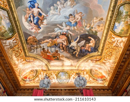 HAMPTON COURT, UK - AUGUST 03, 2014 - Ceiling painting showing christian images inside Hampton Court Palace near London on August 03, 2014