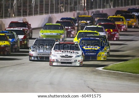 HAMPTON, GA - SEP 05:  Denny Hamlin brings his Sports Clips Toyota down the frontstretch during the Emory Healthcare 500 race at the Atlanta Motor Speedway in Hampton, GA on Sep 05, 2010.