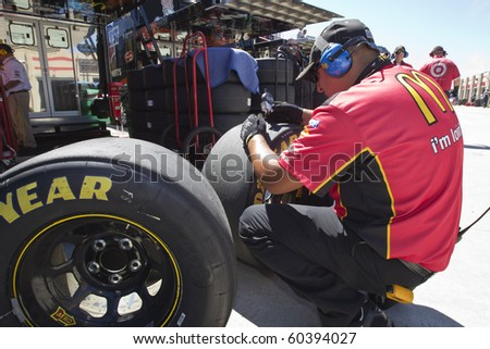 HAMPTON, GA - SEP 04:  The McDonalds crew take measurements on tires during a practice session for the Emory Healthcare 500 race at the Atlanta Motor Speedway in Hampton, GA on Sep 04, 2010.