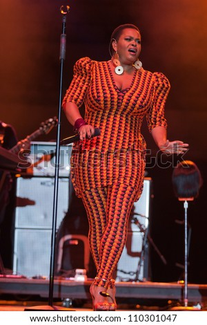 HAMPTON, VIRGINIA - JUNE 23: singer Jill Scott performs on stage at the 45th Hampton Jazz Festival, At Hampton Coliseum - Hampton, Virginia on June 23, 2012 in Hampton, Virginia.