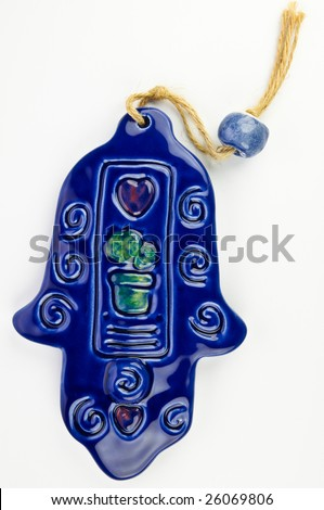 Hamsa hand amulet, used to ward off the evil eye - ceramic wall decoration