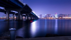 Han river and Seoul city at night, viewed from Yeouido Hangang Park of Seoul, South Korea, long exposure photography for smooth water