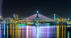 Han River Bridge and the Thuan Phuoc Bridge at night flamboyance on the Han River.  Attracts tourists each occasion tr tong international fireworks competition.